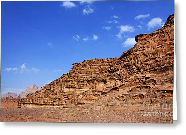 Jordan Photographs Greeting Cards - A landscape of rocky outcrops in the desert of Wadi Rum Jordan Greeting Card by Robert Preston