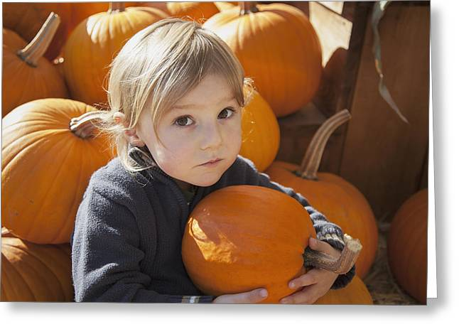 Innocence Child Greeting Cards - A Little Boy Holds One Of Many Pumpkins Greeting Card by Debra Brash