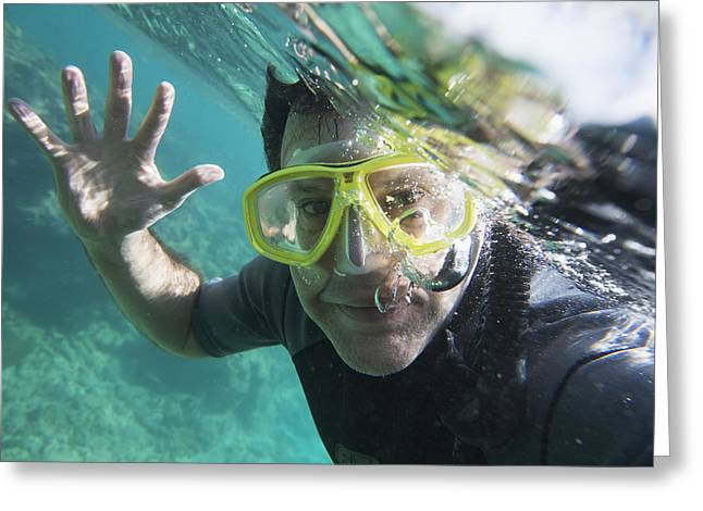 Eye Gestures Greeting Cards - A Male Scuba Diver Waves Hello Greeting Card by Keith Levit