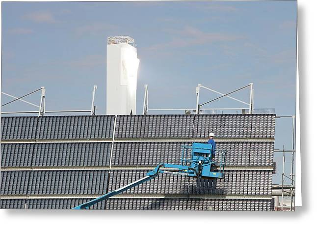 A Man Cleans Solar Panels Greeting Card by Ashley Cooper
