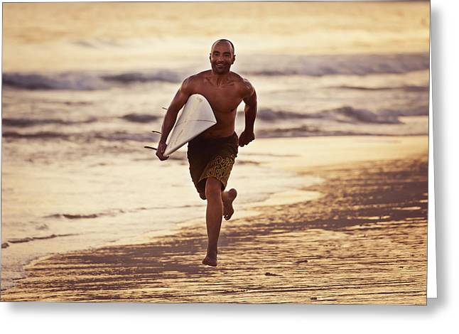 Black Ancestry Greeting Cards - A Man Runs On The Wet Beach At Sunset Greeting Card by Ben Welsh