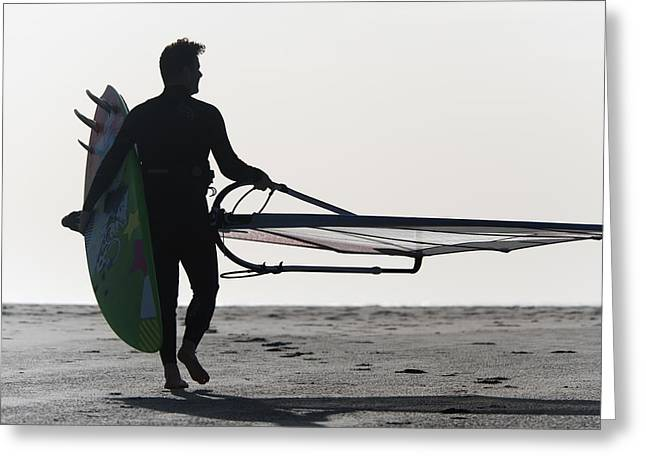Kite Surfing Greeting Cards - A Man Walking On The Beach Carrying A Greeting Card by Ben Welsh