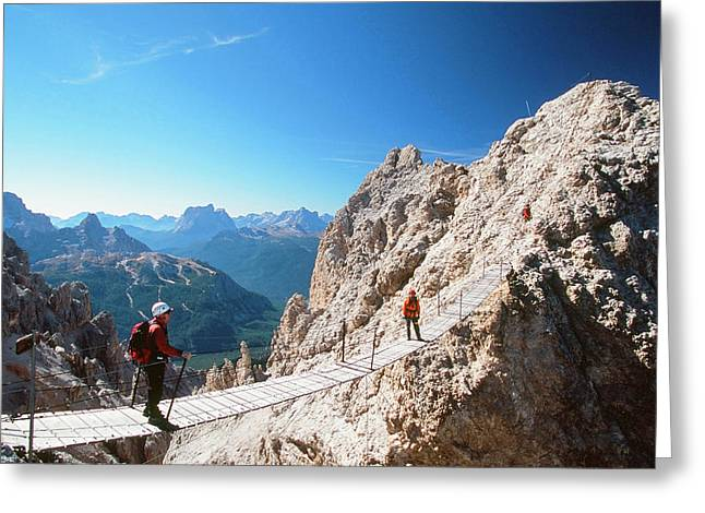 A Mountaineer On A Via Ferrata Greeting Card by Ashley Cooper