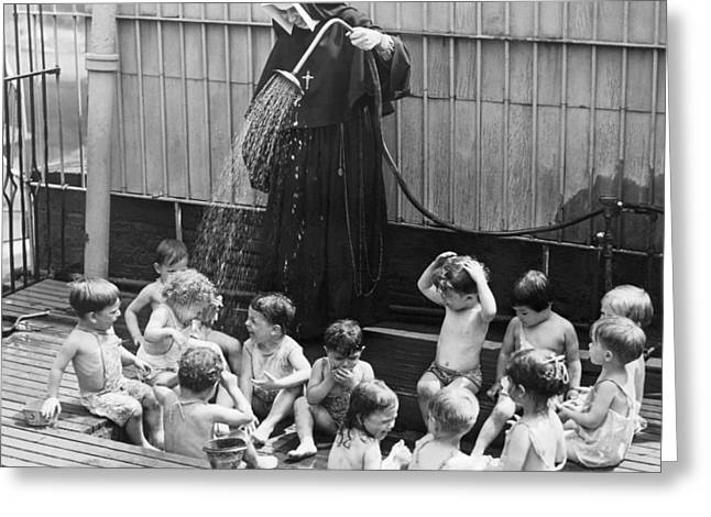 Religious Dress Greeting Cards - A Nun Watering Children Greeting Card by Underwood Archives