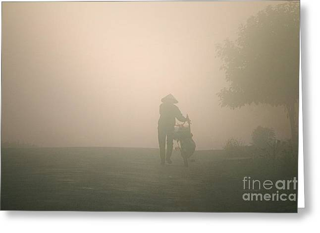 Dalat Greeting Cards - A person walk into the misty foggy forest road in a dramatic  Greeting Card by Duy Black