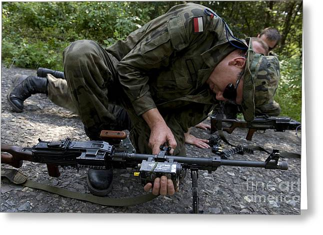 Pk Greeting Cards - A Polish Soldier Attaches A Training Greeting Card by Stocktrek Images