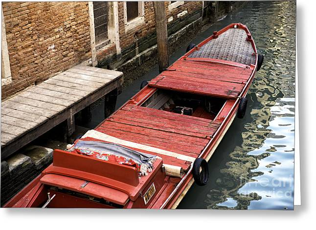 Boats In Water Greeting Cards - A Red Boat in Venice Greeting Card by John Rizzuto