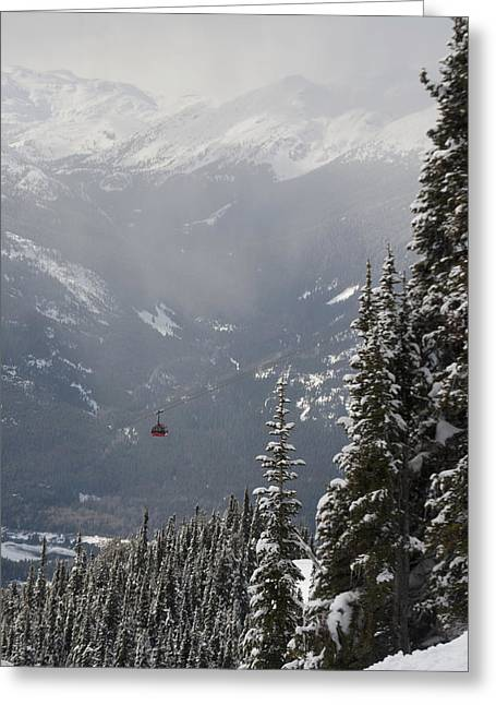 People Greeting Cards - A Red Cable Car Riding Over The Snow Greeting Card by Keith Levit