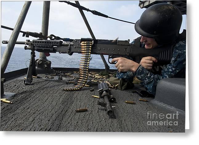 Enterprise Photographs Greeting Cards - A Sailor Fires An M-240b Machine Gun Greeting Card by Stocktrek Images