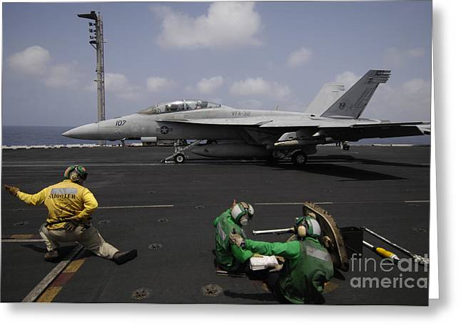 F-18 Greeting Cards - A Shooter Signals For The Launching Greeting Card by Stocktrek Images