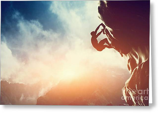 Ambition Photographs Greeting Cards - A silhouette of man climbing on rock mountain Greeting Card by Michal Bednarek