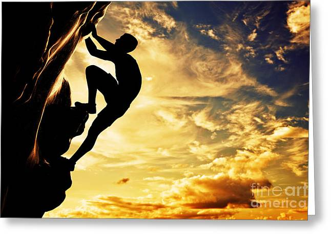 Ambition Photographs Greeting Cards - A silhouette of man free climbing on rock mountain at sunset Greeting Card by Michal Bednarek