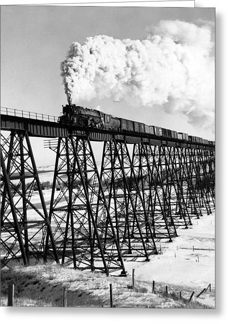 A Steam Engine On Trestle Greeting Card by Underwood Archives
