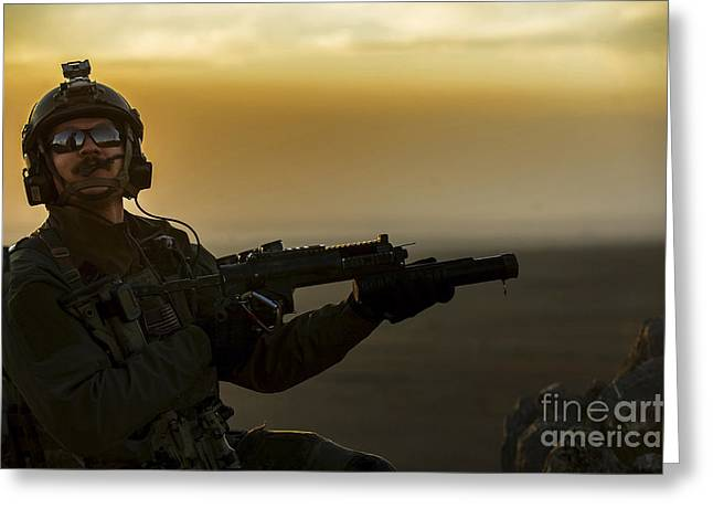 Launcher Greeting Cards - A U.s. Air Force Pararescueman Provides Greeting Card by Stocktrek Images