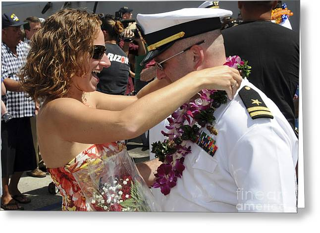 Wavy Hair Greeting Cards - A U.s. Navy Sailor Embraces His Wife Greeting Card by Stocktrek Images