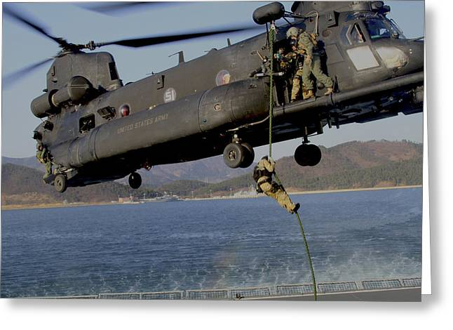 A U.s. Navy Seal Fast-ropes Greeting Card by Stocktrek Images
