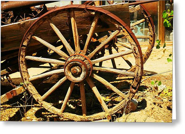 Old Relics Photographs Greeting Cards - A Wagon Wheel Greeting Card by Jeff  Swan