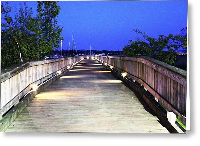 A Walk On The Pier Greeting Card by Judy Palkimas