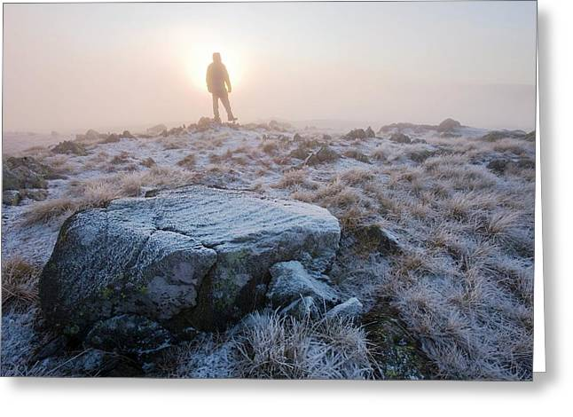 A Walker On The Summit Of Caudale Moor Greeting Card by Ashley Cooper