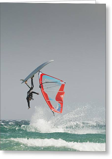 Sailboarding Greeting Cards - A Windsurfer Flips Upside Down On The Greeting Card by Ben Welsh