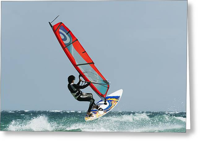 A Windsurfer In The Water Tarifa Greeting Card by Ben Welsh