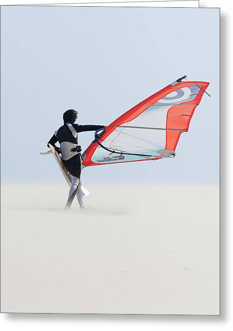 Ground Level Greeting Cards - A Windsurfer Walks On The Sand Of Punta Greeting Card by Ben Welsh