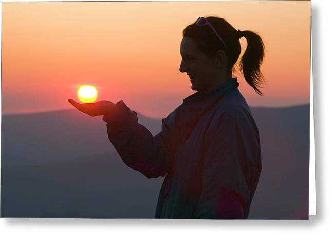 A Woman Holding The Setting Sun Greeting Card by Ashley Cooper
