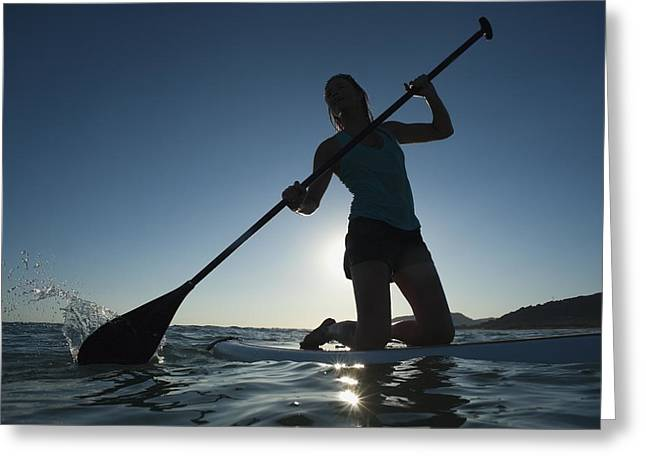 Surf Silhouette Greeting Cards - A Woman Paddling While On Her Knees On Greeting Card by Ben Welsh