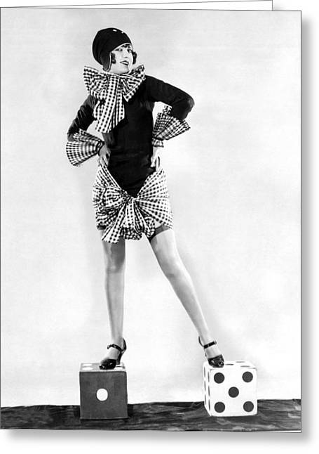 A Woman Standing On Dice Greeting Card by Underwood Archives