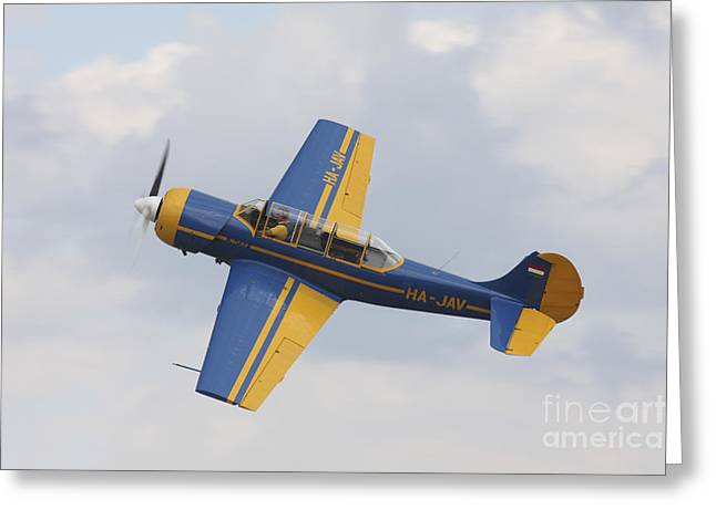 Hradec Greeting Cards - A Yakolev Yak-52 Plane Flying Greeting Card by Timm Ziegenthaler