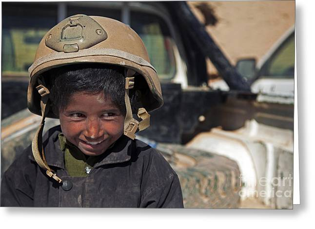 Innocence Child Greeting Cards - A Young Boy Wears A Coalition Force Greeting Card by Stocktrek Images