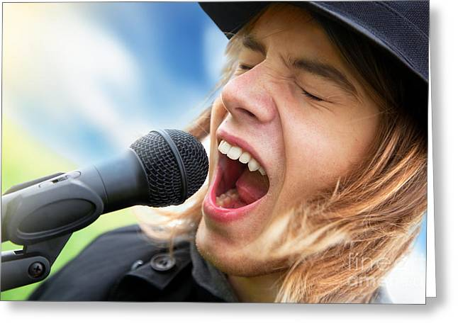 A Young Man Sings To A Microphone Greeting Card by Michal Bednarek
