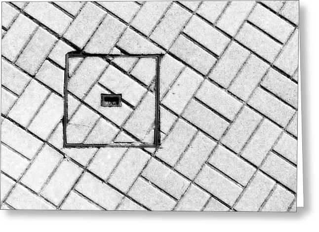 Sewer Greeting Cards - Abstraction Of Sewer Manhole On Floor With Cobblestones Greeting Card by Mikel Martinez de Osaba