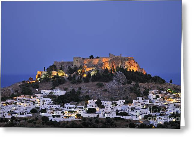 Dodekanissos Greeting Cards - Acropolis and village of Lindos during dusk time Greeting Card by George Atsametakis