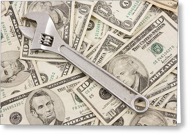 Financial Crisis Greeting Cards - Adjustable Wrench On Pile Of Money Greeting Card by Keith Webber Jr