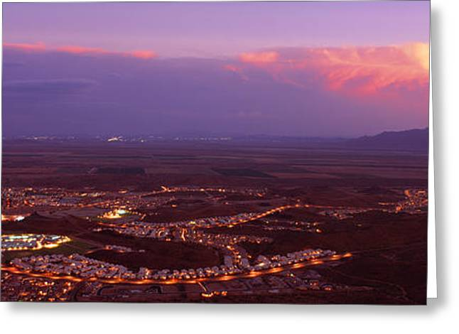 Thunderstorm Greeting Cards - Aerial View Of A City Lit Up At Sunset Greeting Card by Panoramic Images