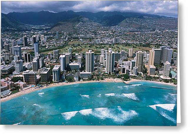 Beach Photography Greeting Cards - Aerial View Of A City, Waikiki Beach Greeting Card by Panoramic Images