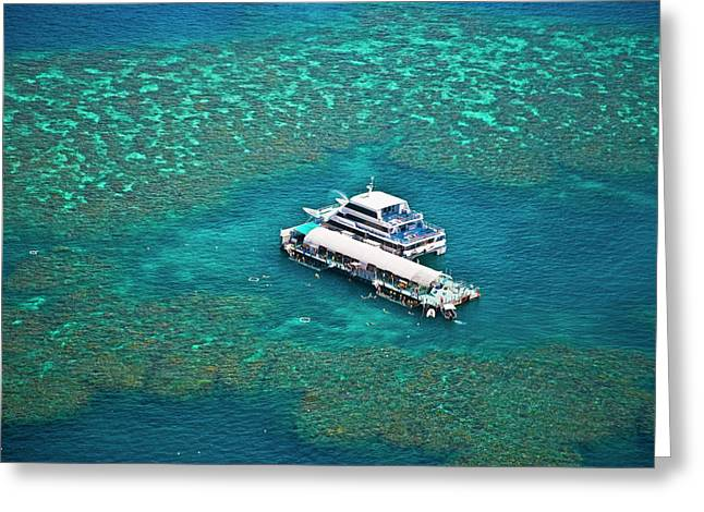 Aerial View Of A Tour Boat Docked Greeting Card by Miva Stock