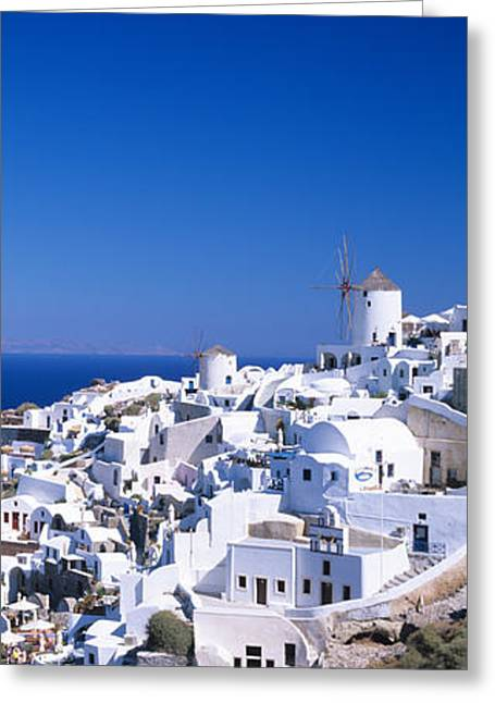 Oia Greeting Cards - Aerial View Of Houses In A Town, Oia Greeting Card by Panoramic Images