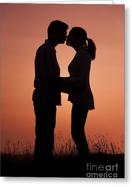Woman In Summer Meadow Greeting Cards - Affectionate Couple At Sunset In Profile  Greeting Card by Lee Avison