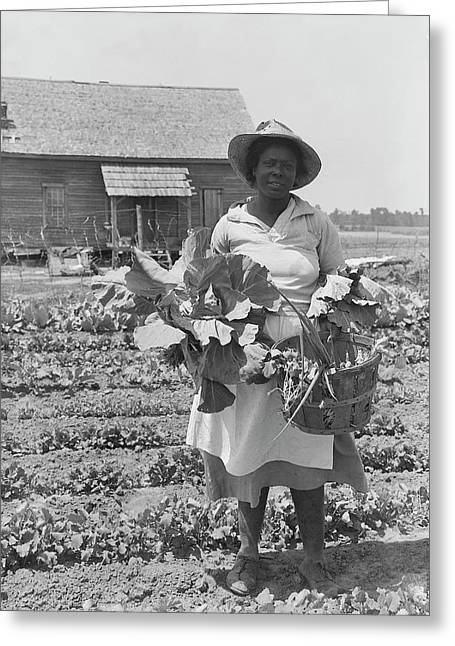 African-american Woman Picking Greeting Card by Stocktrek Images