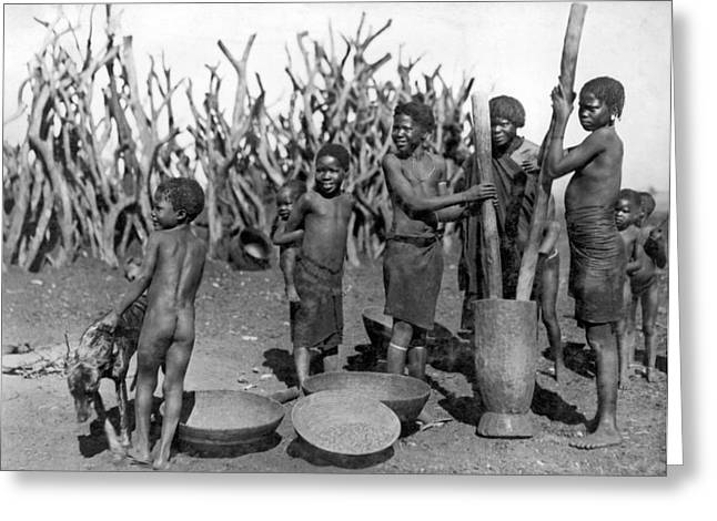 African Girls Grinding Corn Greeting Card by Underwood Archives