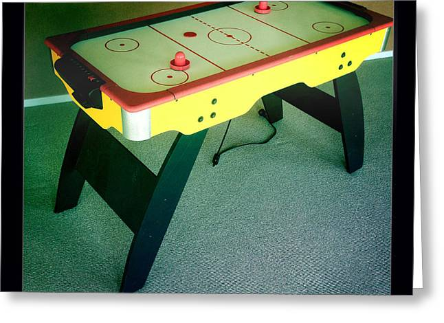 Air hockey table Greeting Card by Les Cunliffe