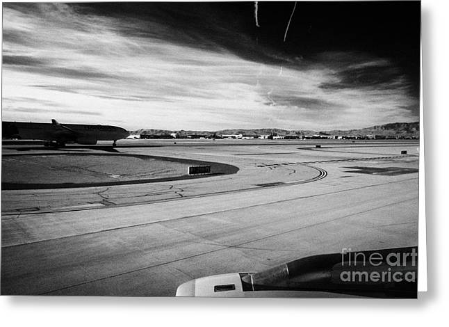 Taxiway Greeting Cards - aircraft on runway and taxiway waiting to take off at McCarran International airport Las Vegas Nevad Greeting Card by Joe Fox