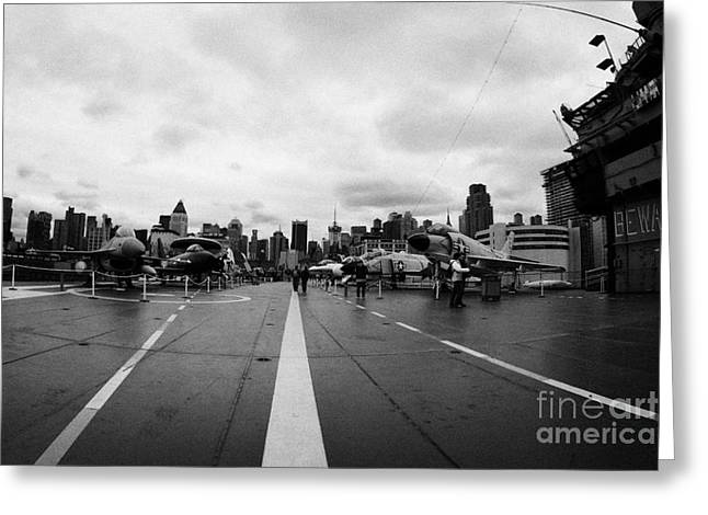 Manhaten Greeting Cards - Aircraft on the flight deck of the USS Intrepid and flight island looking towards manhattan Greeting Card by Joe Fox