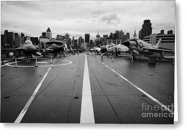 Manhaten Greeting Cards - Aircraft on the flight deck of the USS Intrepid looking towards manhattan new york Greeting Card by Joe Fox