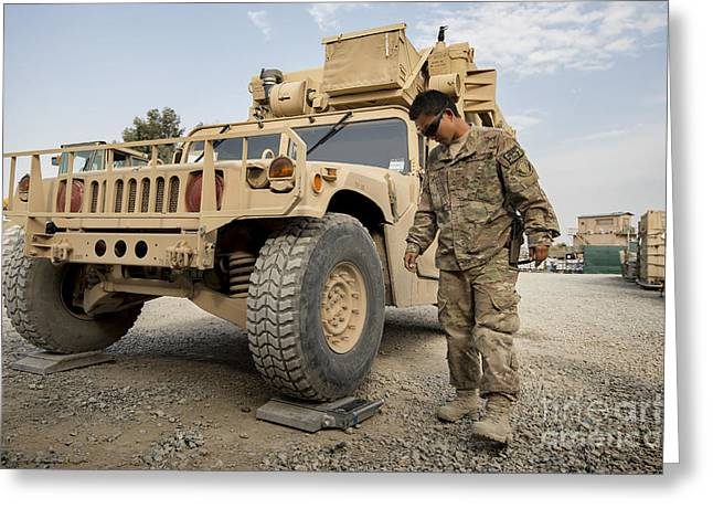 Airman Checks The Weight Of A Vehicle Greeting Card by Stocktrek Images