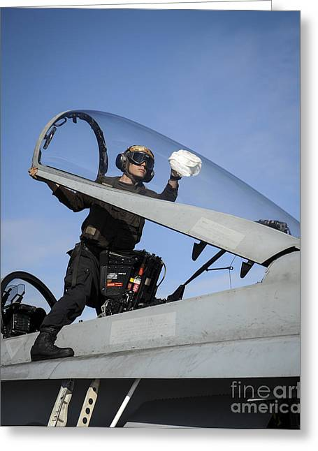 Military Airplanes Greeting Cards - Airman Cleans The Canopy Of An Fa-18c Greeting Card by Stocktrek Images