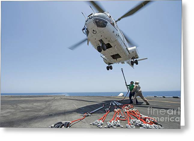 Hovering Greeting Cards - Airmen Attach A Cargo Hook To An Greeting Card by Stocktrek Images