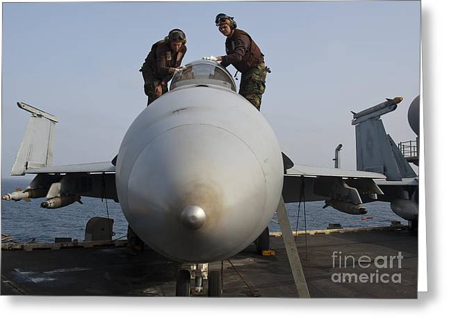 Airmen Clean The Canopy Of An Fa-18f Greeting Card by Stocktrek Images